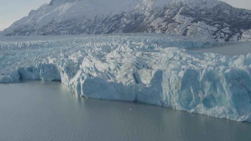 4K stock footage aerial video flying toward edge of glacier on Inner Lake George, snow covered peak, Alaska Aerial Stock Footage | AK0001_1445