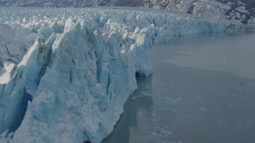 4K stock footage aerial video flying along edge of snow covered glacier on Inner Lake George, Alaska Aerial Stock Footage | AK0001_1446