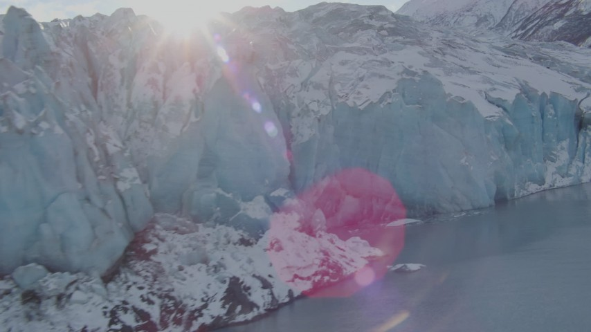 4K stock footage aerial video the edge of a snow covered glacier on Inner Lake George, Alaska Aerial Stock Footage | AK0001_1450