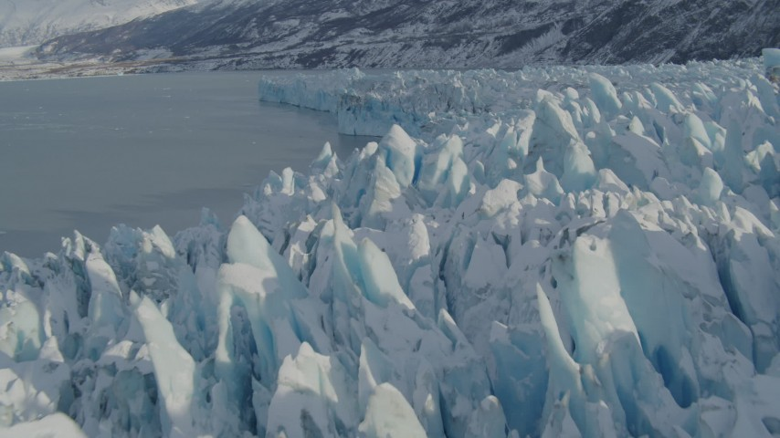 4K stock footage aerial video flying over jagged, snowy surface of glacier on Inner Lake George, Alaska Aerial Stock Footage | AK0001_1453