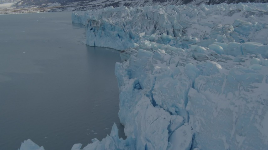 4K stock footage aerial video flying over edge of snow covered glacier on Inner Lake George, Alaska Aerial Stock Footage | AK0001_1454
