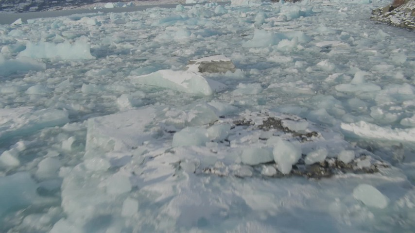 4K stock footage aerial video flying low over pieces of ice on Inner Lake George, Alaska in snow Aerial Stock Footage | AK0001_1458