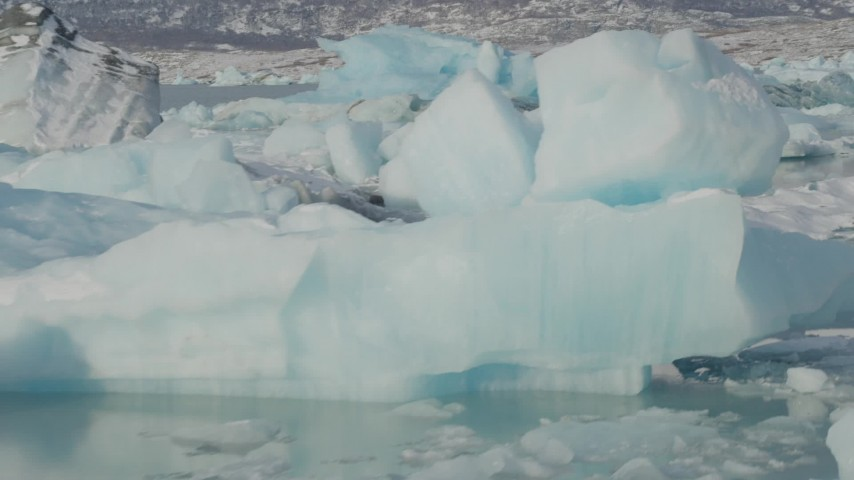 4K stock footage aerial video flying over pieces of glacial ice on Inner Lake George, Alaska in snow Aerial Stock Footage | AK0001_1459
