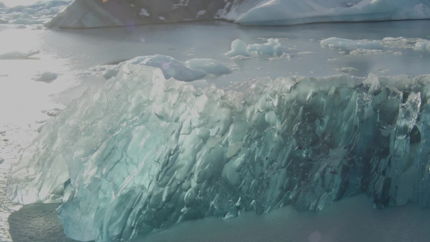 4K stock footage aerial video flyby blue glacial ice on Inner Lake George, Alaska in snow Aerial Stock Footage AK0001_1461 | Axiom Images