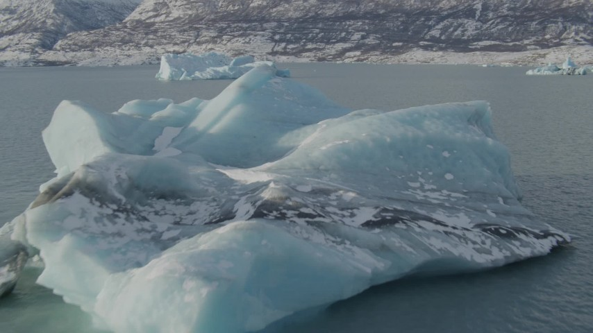 4K stock footage aerial video flying over surface of Inner Lake George toward pieces of glacial ice, Alaska in snow Aerial Stock Footage | AK0001_1466