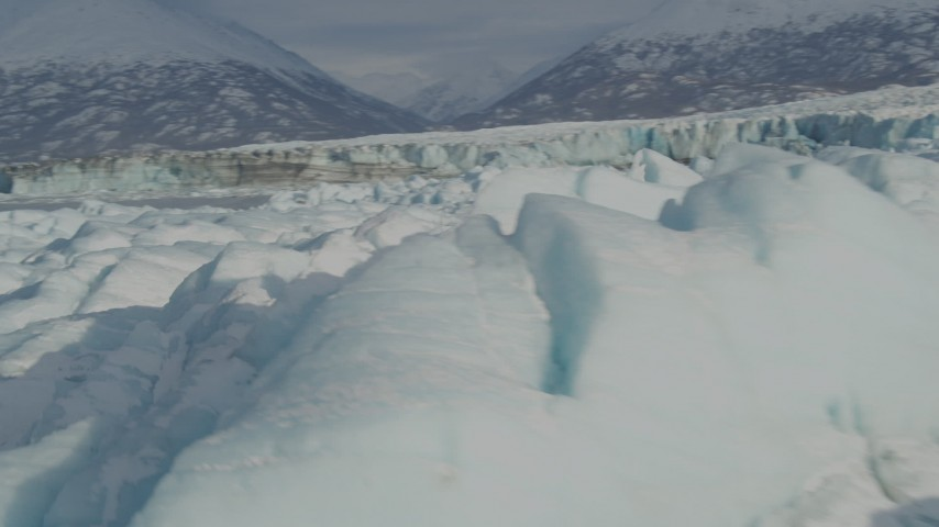 4K stock footage aerial video flying over surface of the snow covered glacier on Inner Lake George, Alaska Aerial Stock Footage | AK0001_1479