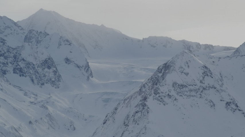 4K aerial video a snowy valley surrounded by Chugach Mountains, Alaska Aerial Stock Footage | AK0001_1489