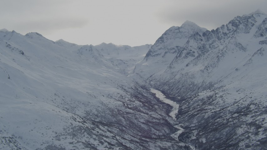 4K stock footage aerial video icy river between snow covered ranges in the Chugach Mountains, Alaska Aerial Stock Footage | AK0001_1490