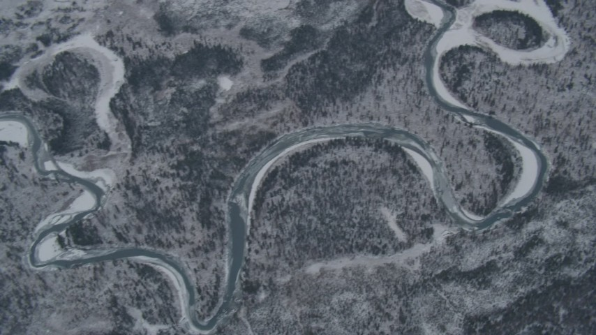 4K stock footage aerial video pan along Eagle River revealing snowy neighborhoods at end of valley, Alaska Aerial Stock Footage | AK0001_1505