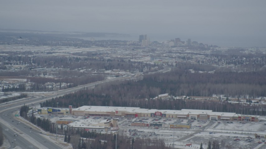 4K stock footage aerial video snow covered Downtown Anchorage, flying behind plume of steam, Alaska Aerial Stock Footage | AK0001_1514