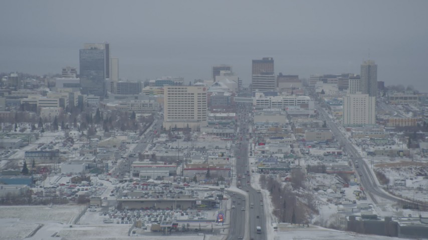 4K stock footage aerial video snow covered Downtown Anchorage skyline seen from East 5th Avenue, Alaska Aerial Stock Footage | AK0001_1519