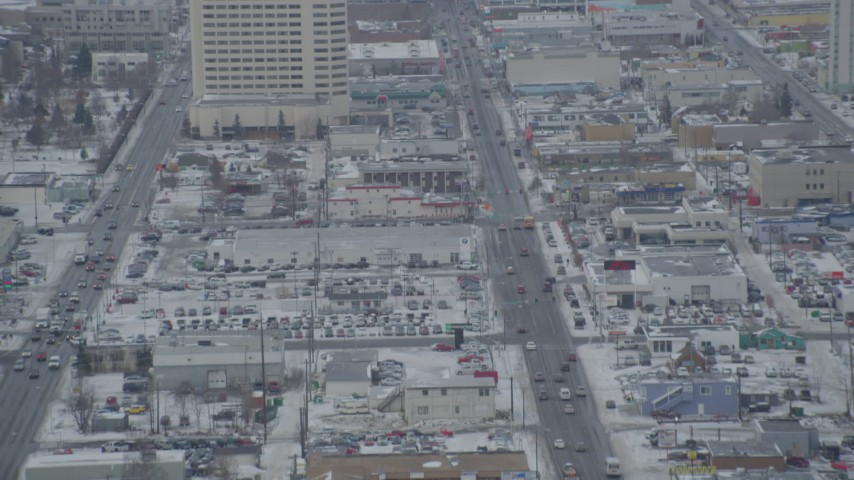 4K stock footage aerial video following East 5th Avenue in snow, Downtown Anchorage, Alaska Aerial Stock Footage | AK0001_1520