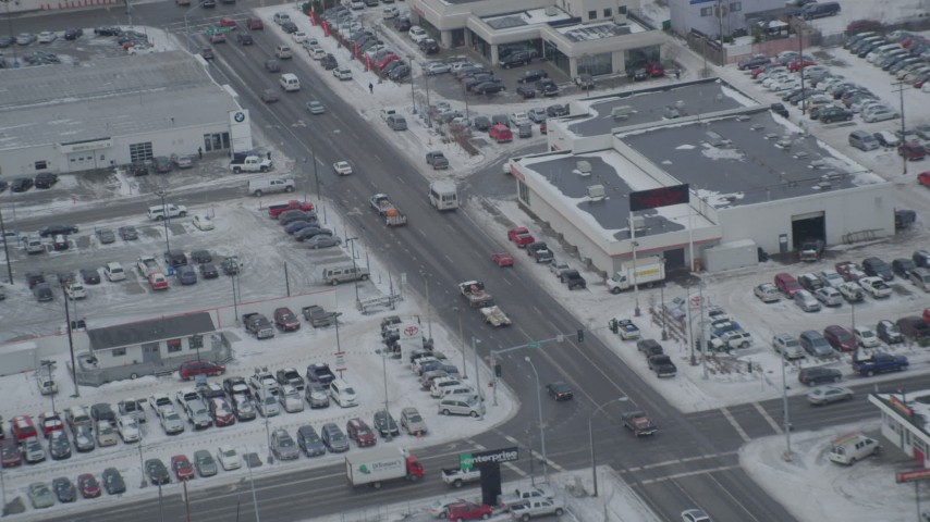 4K stock footage aerial video snow covered auto dealerships on East 5th Avenue, Downtown Anchorage, Alaska Aerial Stock Footage | AK0001_1521