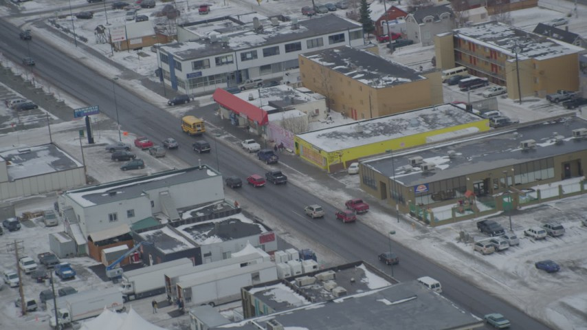 4K stock footage aerial video light traffic on East 5th Avenue in Downtown Anchorage, Alaska in snow Aerial Stock Footage | AK0001_1522