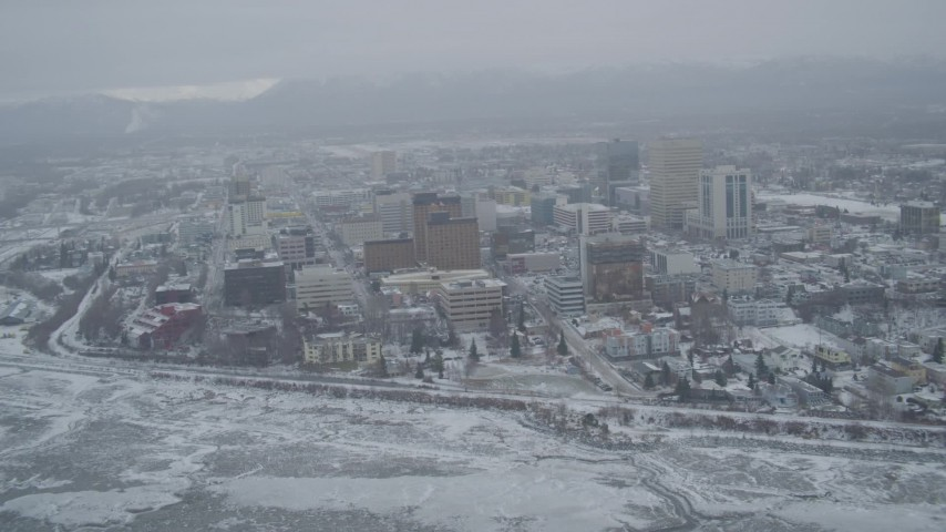 4K stock footage aerial video snow covered Downtown Anchorage from shore of the Cook Inlet, Alaska Aerial Stock Footage | AK0001_1523