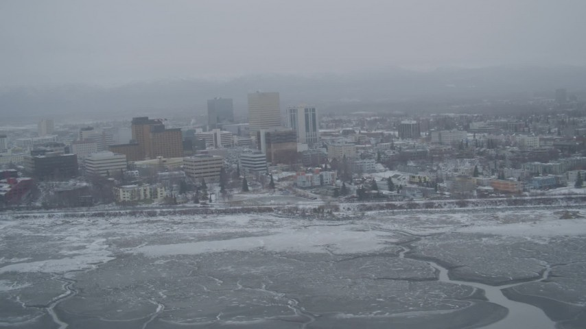 4K stock footage aerial video flying away from snow covered Downtown Anchorage, Alaska Aerial Stock Footage | AK0001_1525