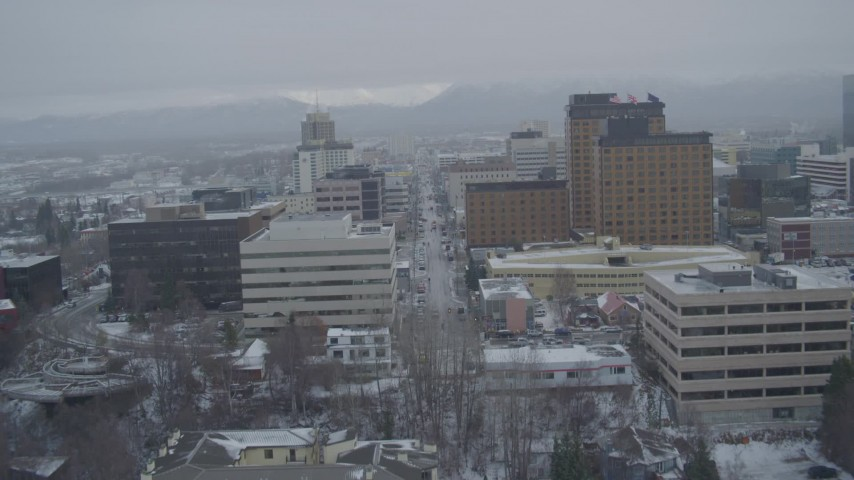 4K stock footage aerial video fly over Cook Inlet, West 4th Avenue, snowy Downtown Anchorage, Alaska Aerial Stock Footage | AK0001_1526