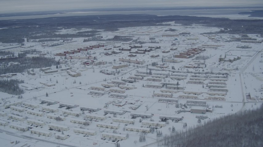 4K aerial video snow covered Fort Richardson residential neighborhoods, Anchorage, Alaska Aerial Stock Footage | AK0001_1530