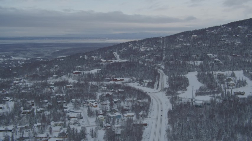 4K stock footage aerial video following Eagle River Loop Road through snow covered neighborhoods, Alaska Aerial Stock Footage | AK0001_1536