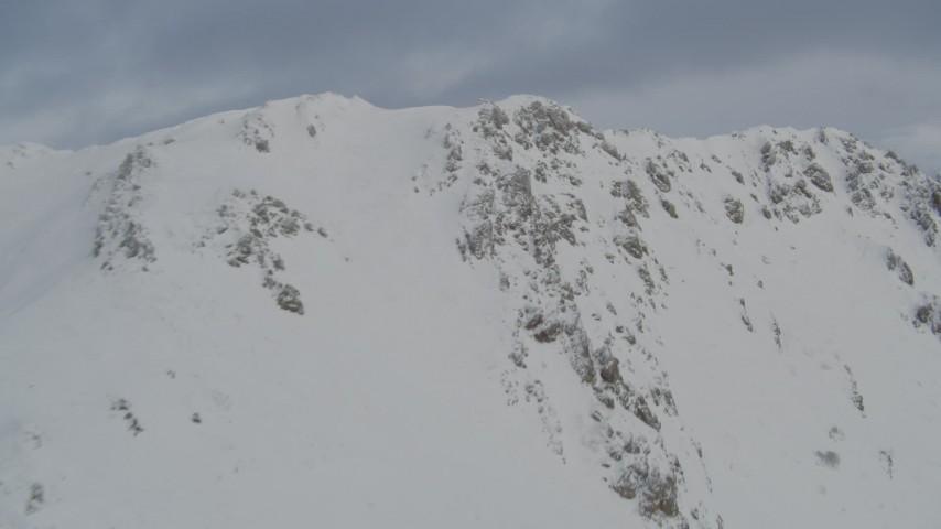 4K aerial video flying up snowy mountain slopes, Chugach Mountains, Alaska Aerial Stock Footage | AK0001_1544