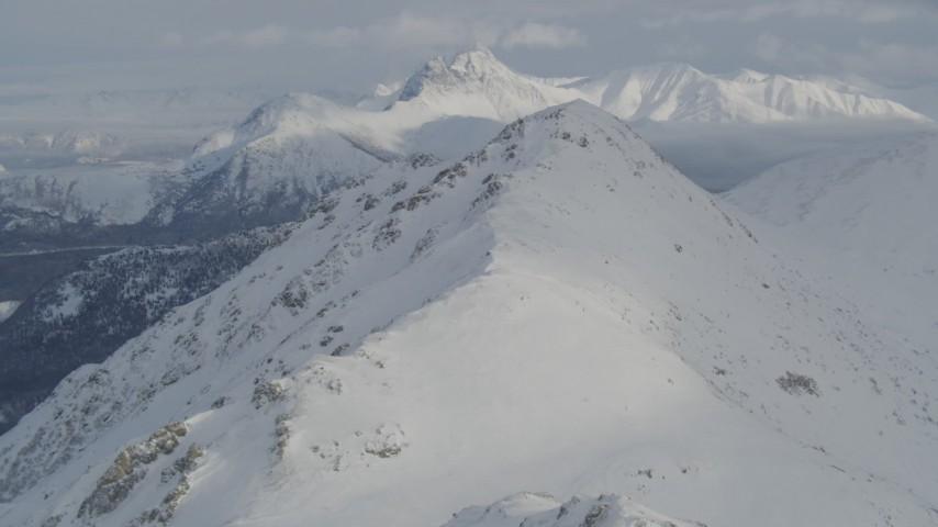 4K stock footage aerial video flying over snowy mountain ridge toward summit, Chugach Mountains, Alaska Aerial Stock Footage | AK0001_1545