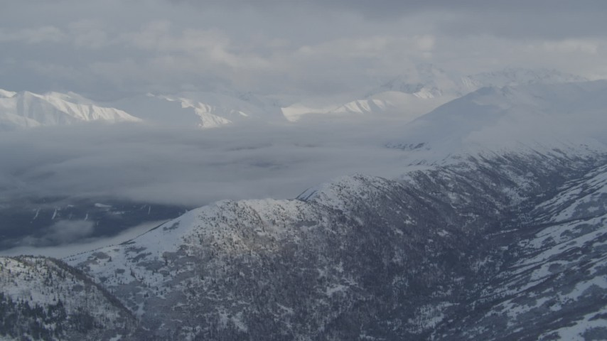 4K stock footage aerial video flyby snowy mountain ridges, Eklutna Lake Valley, Chugach Mountains, Alaska Aerial Stock Footage | AK0001_1548