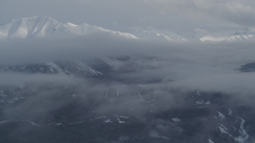 4K stock footage aerial video approach clouds and snowy Chugach Mountains in winter, Alaska  Aerial Stock Footage | AK0001_1550