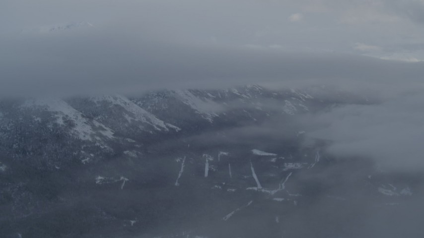 4K stock footage aerial video flying through clouds toward snowy Chugach Mountains, Alaska Aerial Stock Footage | AK0001_1551