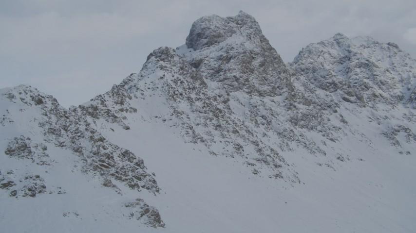 4K stock footage aerial video flying toward rocky, snowy mountain summits in Chugach Mountains, Alaska Aerial Stock Footage   AK0001_1558