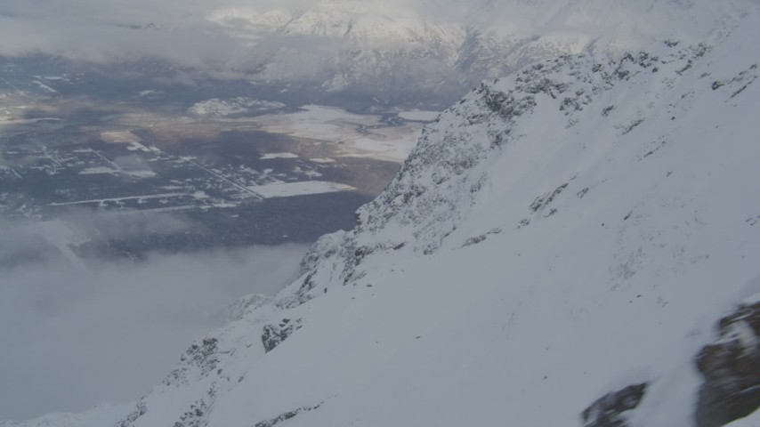 4K stock footage aerial video the town of Butte seen from snowy Chugach Mountains, Alaska Aerial Stock Footage | AK0001_1566