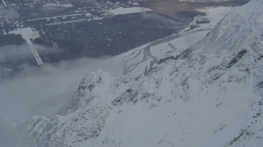 4K stock footage aerial video Knik River near Butte seen from snow covered Chugach Mountains, Alaska Aerial Stock Footage | AK0001_1568
