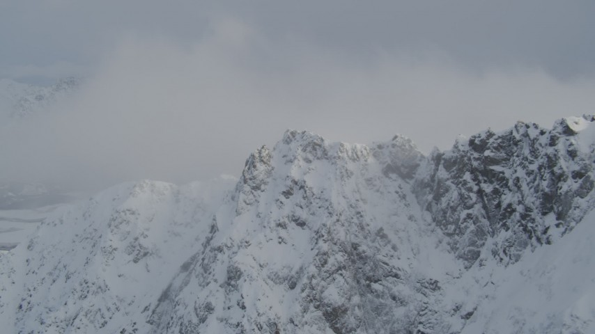 4K stock footage aerial video snow covered mountain summit, Knik River Valley, Chugach Mountains, Alaska Aerial Stock Footage | AK0001_1569