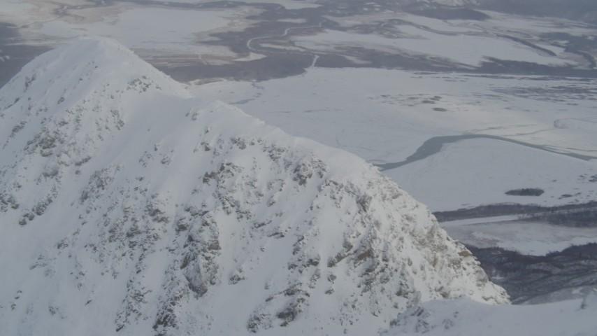 4K stock footage aerial video flying through clouds toward snowy mountain ridge, Chugach Mountains, Alaska Aerial Stock Footage | AK0001_1570