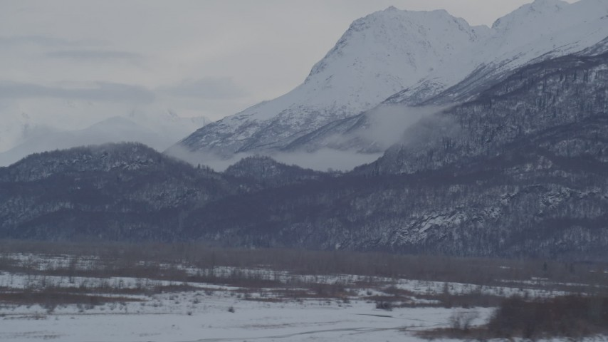 4K stock footage aerial video the snow covered Chugach Mountains seen from Knik River Valley, Alaska Aerial Stock Footage | AK0001_1594
