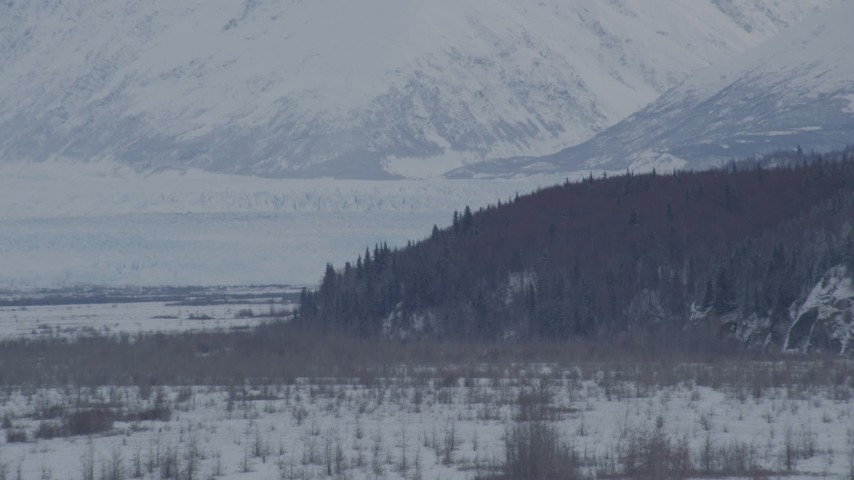 4K aerial video the snow covered Knik Glacier seen from Knik River Valley, Alaska Aerial Stock Footage | AK0001_1596