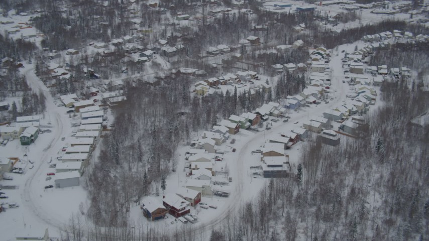 4K aerial video approaching Eagle River, snow covered, residential neighborhoods, Alaska Aerial Stock Footage | AK0001_1632