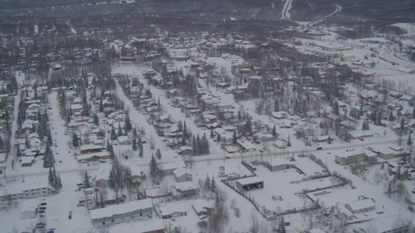 4K aerial video flying over Eagle River residential neighborhoods, covered in snow, Alaska Aerial Stock Footage | AK0001_1633