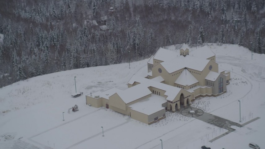 4K stock footage aerial video approaching a church in snow covered Eagle River, Alaska Aerial Stock Footage | AK0001_1634
