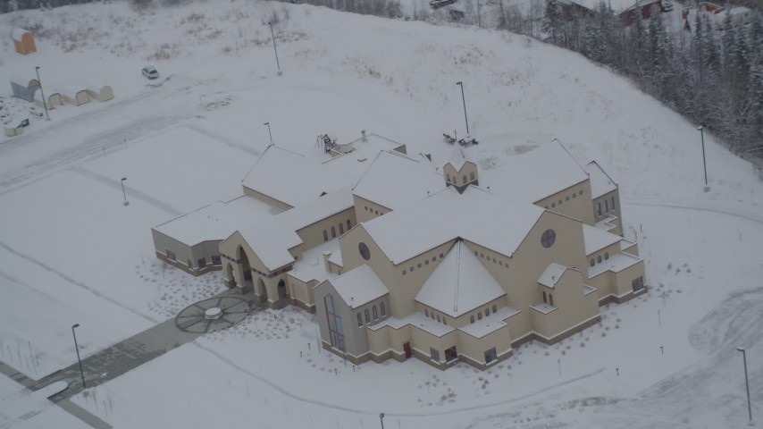4K stock footage aerial video orbiting a snow covered church in Eagle River, Alaska Aerial Stock Footage | AK0001_1635
