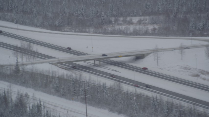 4K aerial video cars on Glenn Highway past D Street overpass, Anchorage, Alaska in snow Aerial Stock Footage | AK0001_1640
