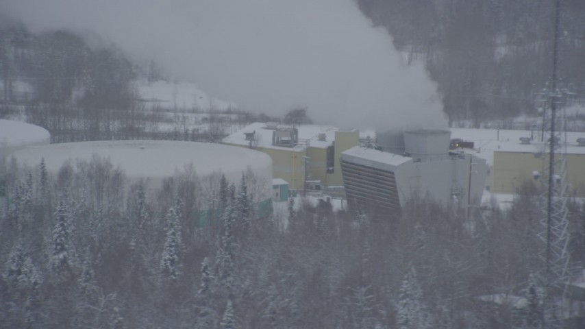 4K stock footage aerial video passing a power plant in Anchorage, Alaska in snow Aerial Stock Footage | AK0001_1642