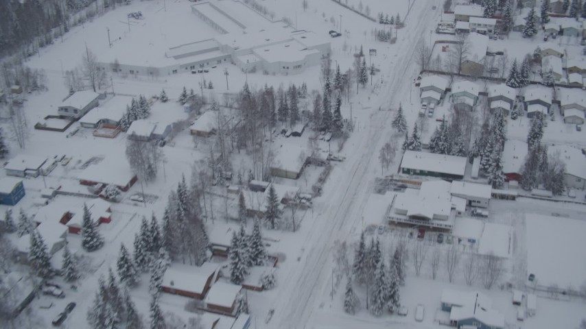 4K stock footage aerial video flying over snow covered residential neighborhoods, Anchorage, Alaska Aerial Stock Footage | AK0001_1643