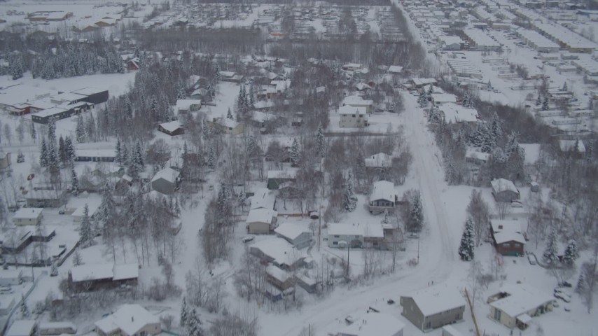 4K aerial  video flying over snowy neighborhoods and mobile home parks, Anchorage, Alaska Aerial Stock Footage | AK0001_1644