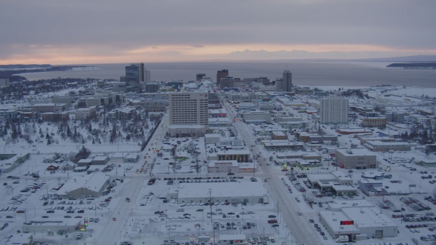 4K stock footage aerial video flying over snow covered Downtown Anchorage at twilight, Alaska Aerial Stock Footage AK0001_1651 | Axiom Images