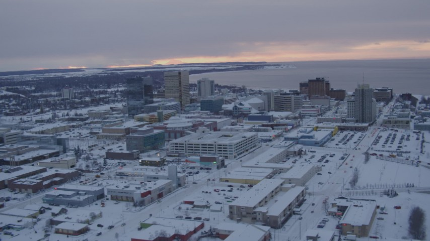 4K stock footage aerial video flying over snow covered Downtown Anchorage at twilight, Alaska Aerial Stock Footage | AK0001_1652
