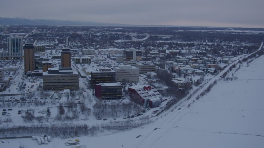 4K stock footage aerial video snowy Downtown Anchorage, flying over shore of Cook Inlet at twilight, Alaska Aerial Stock Footage | AK0001_1654