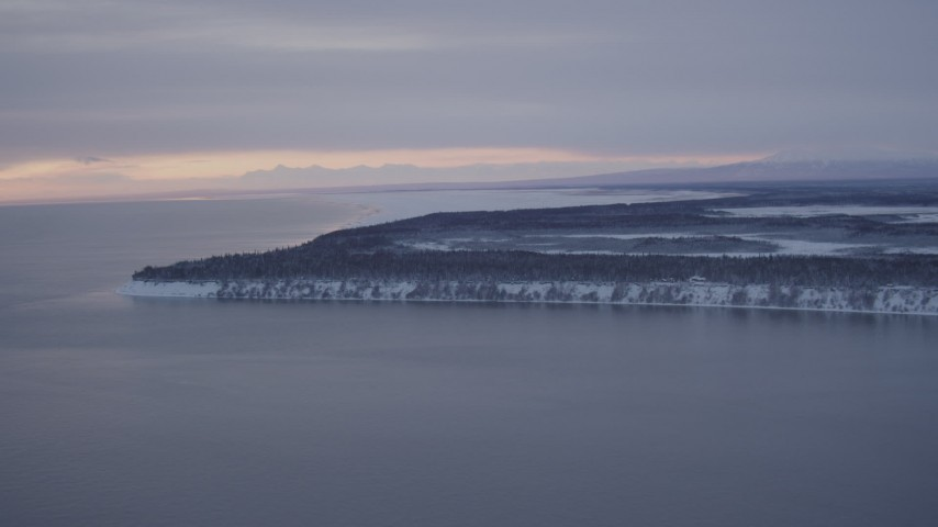 4K stock footage aerial video flying toward snowy Point MacKenzie at twilight, Alaska Aerial Stock Footage | AK0001_1662
