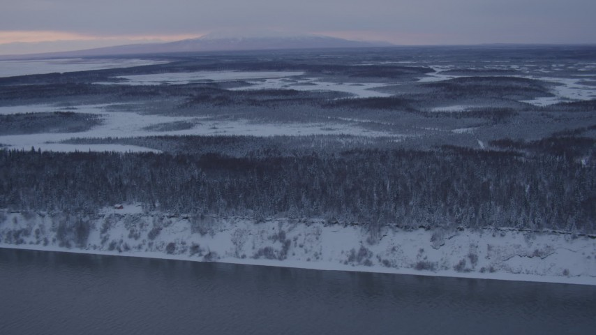 4K stock footage aerial video flying over snow covered woods of Point MacKenzie at twilight, Alaska Aerial Stock Footage | AK0001_1663