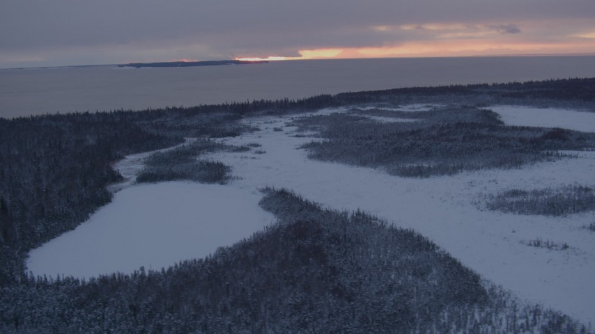 4K stock footage aerial video Fire Island seen from snow covered Point MacKenzie at twilight, Alaska Aerial Stock Footage | AK0001_1664