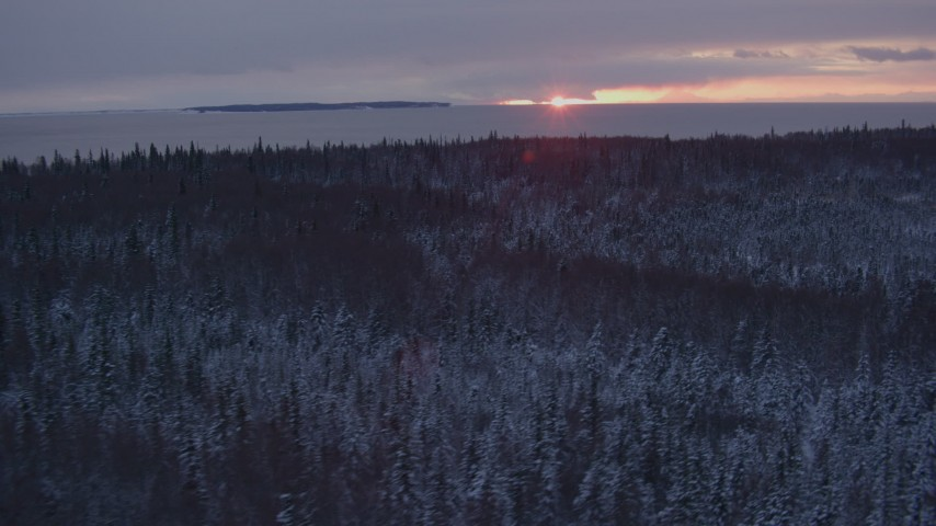 4K stock footage aerial video flying over snow covered forest on Point MacKenzie at sunset, Alaska Aerial Stock Footage AK0001_1674 | Axiom Images